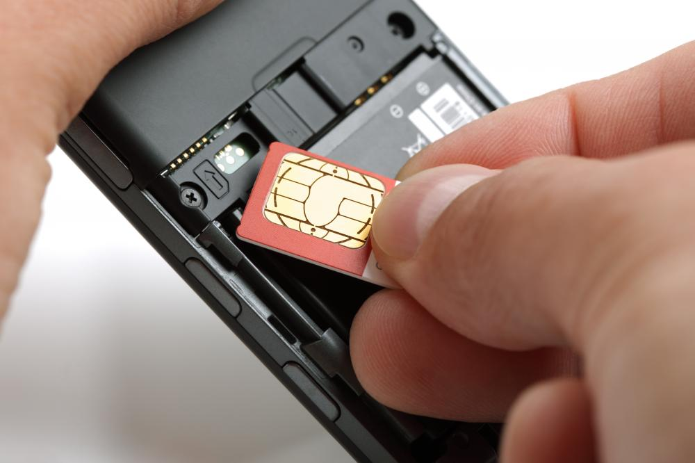 sim-card-being-placed-into-a-mobile-phone